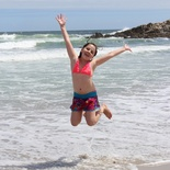 Jumping for joy to be at the beach